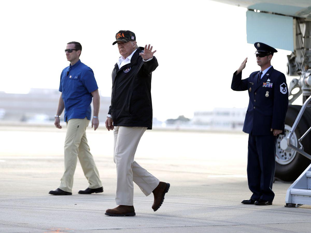 The Latest: Trump tours wildfire-ravaged Malibu area