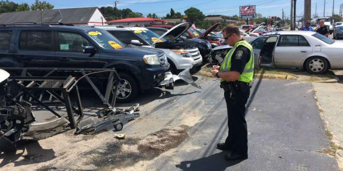 Vehicles in dealer's lot damaged in wreck