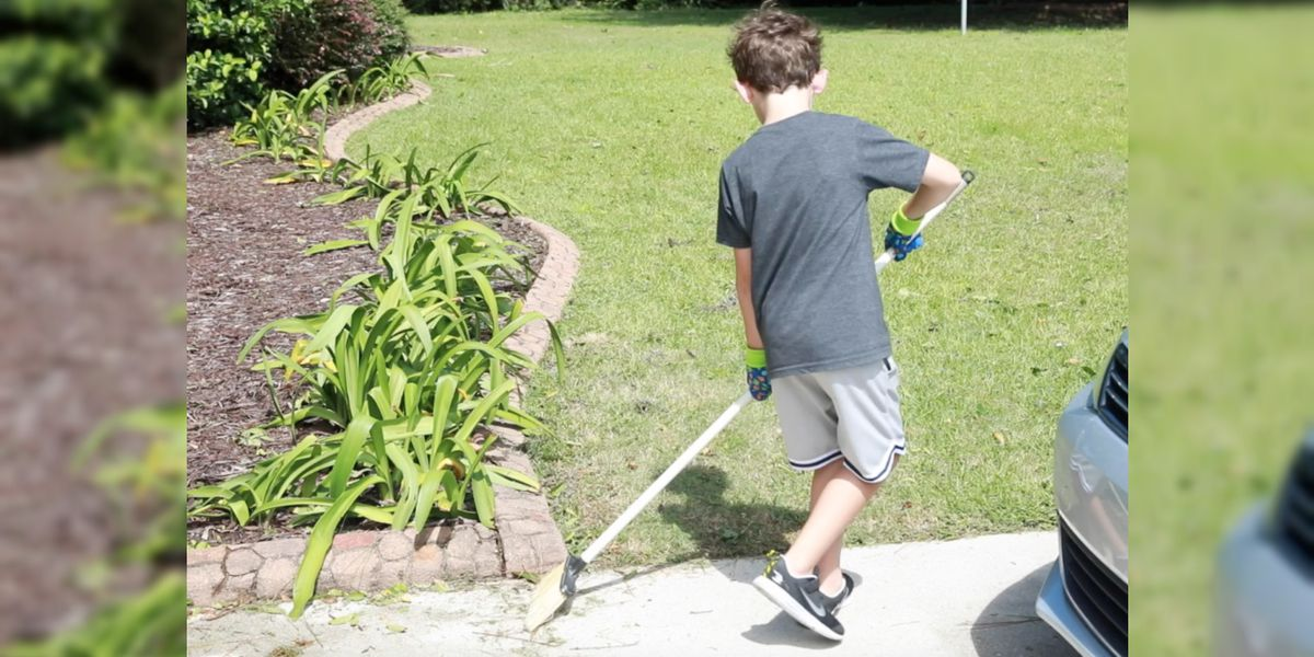 With broom in tow, 6-year-old helps clean up his Porters Neck neighborhood