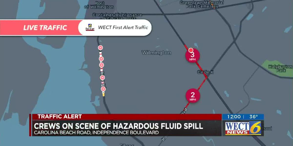 Crews work to clean hazardous fluid spill from road