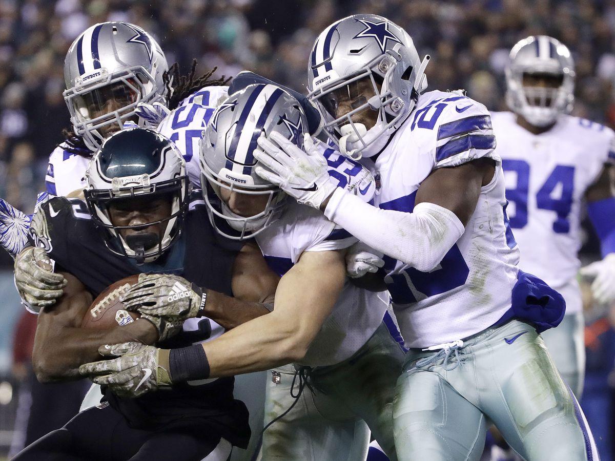 Elliott, Prescott lead Cowboys past Eagles 27-20