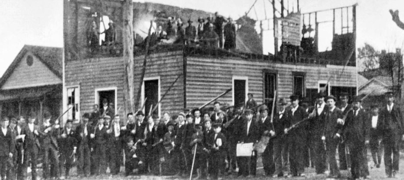 """Angry white supremacists burned down """"The Daily Record,"""" a black-owned newspaper, on Nov. 10, 1898. (Source: Wikipedia)"""