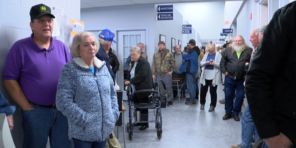 Flooding victims listen to options at FEMA meeting