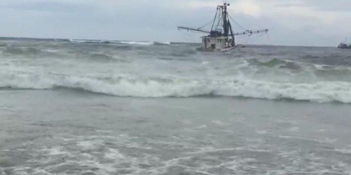 Stuck shrimp boat on Holden Beach finally back in the ocean