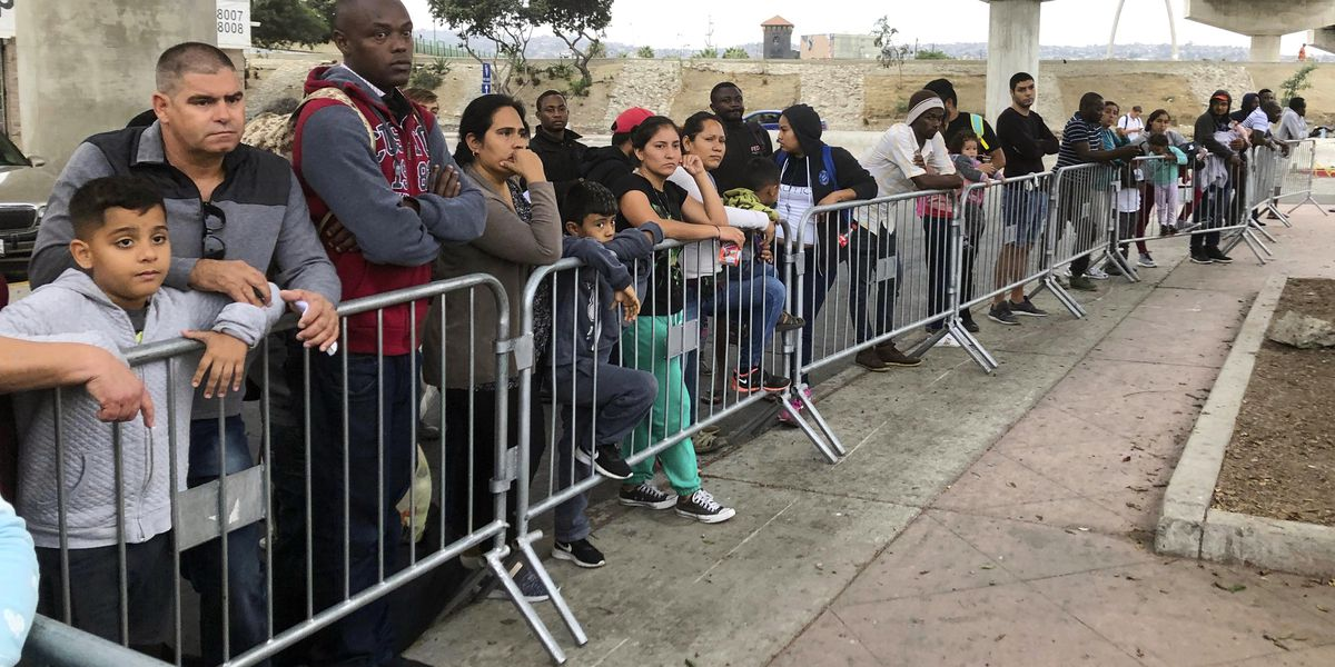 US lets in asylum-seekers stuck in Mexico, ends Trump policy