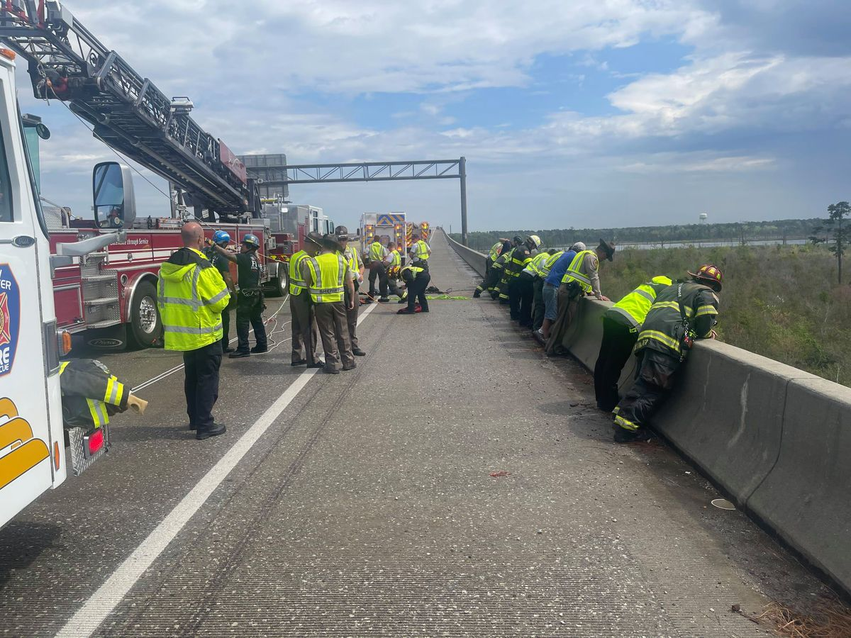 Woman saved after jumping off I-140 bridge