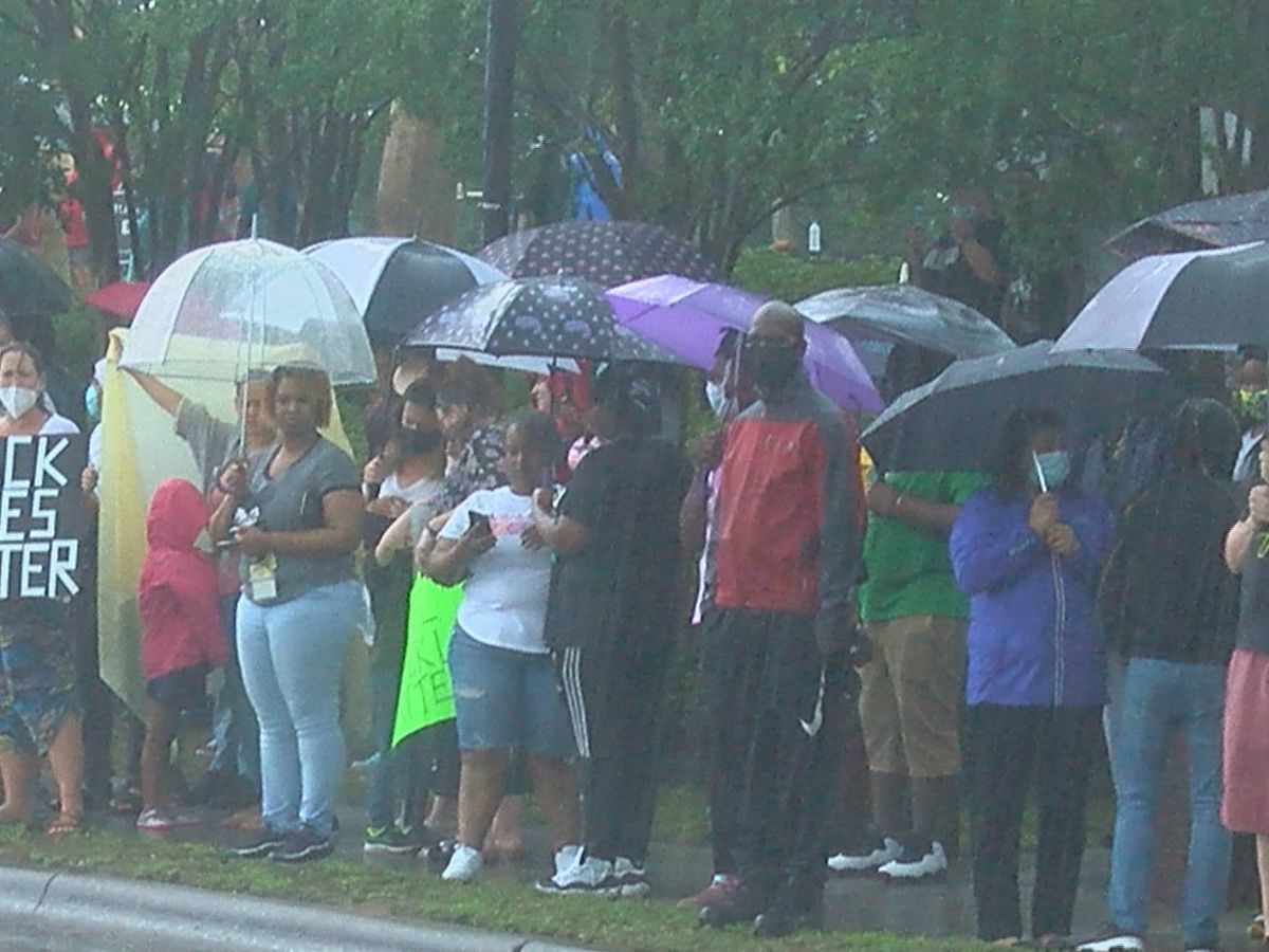'It showed the spirit of this city:' Crowds brave the elements to stand in solidarity for George Floyd