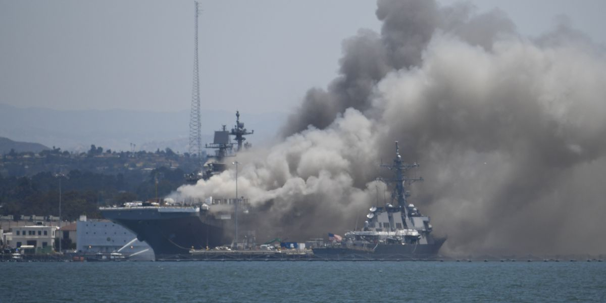 Fire ravages ship for 2nd day; sends acrid haze over city