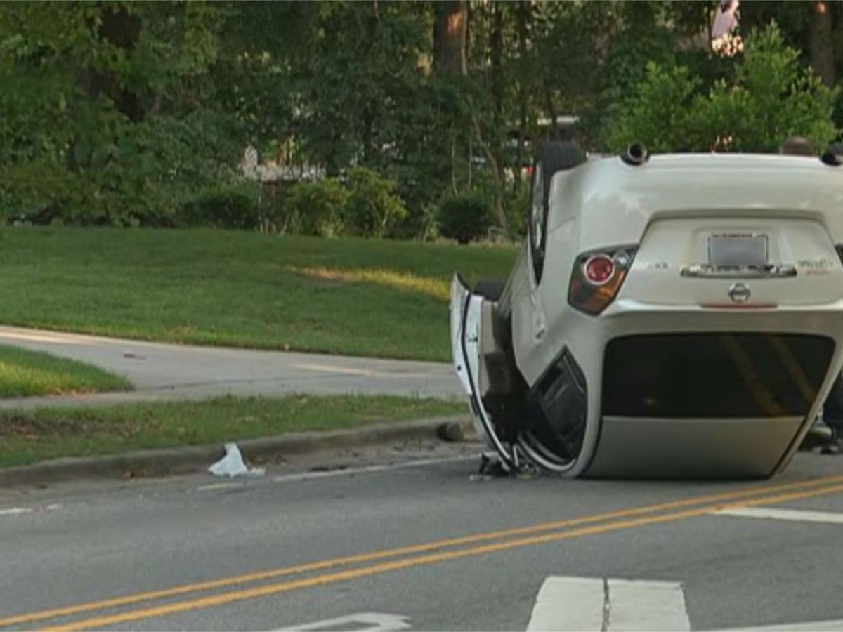 Car overturns after hitting tree on Colonial Dr.