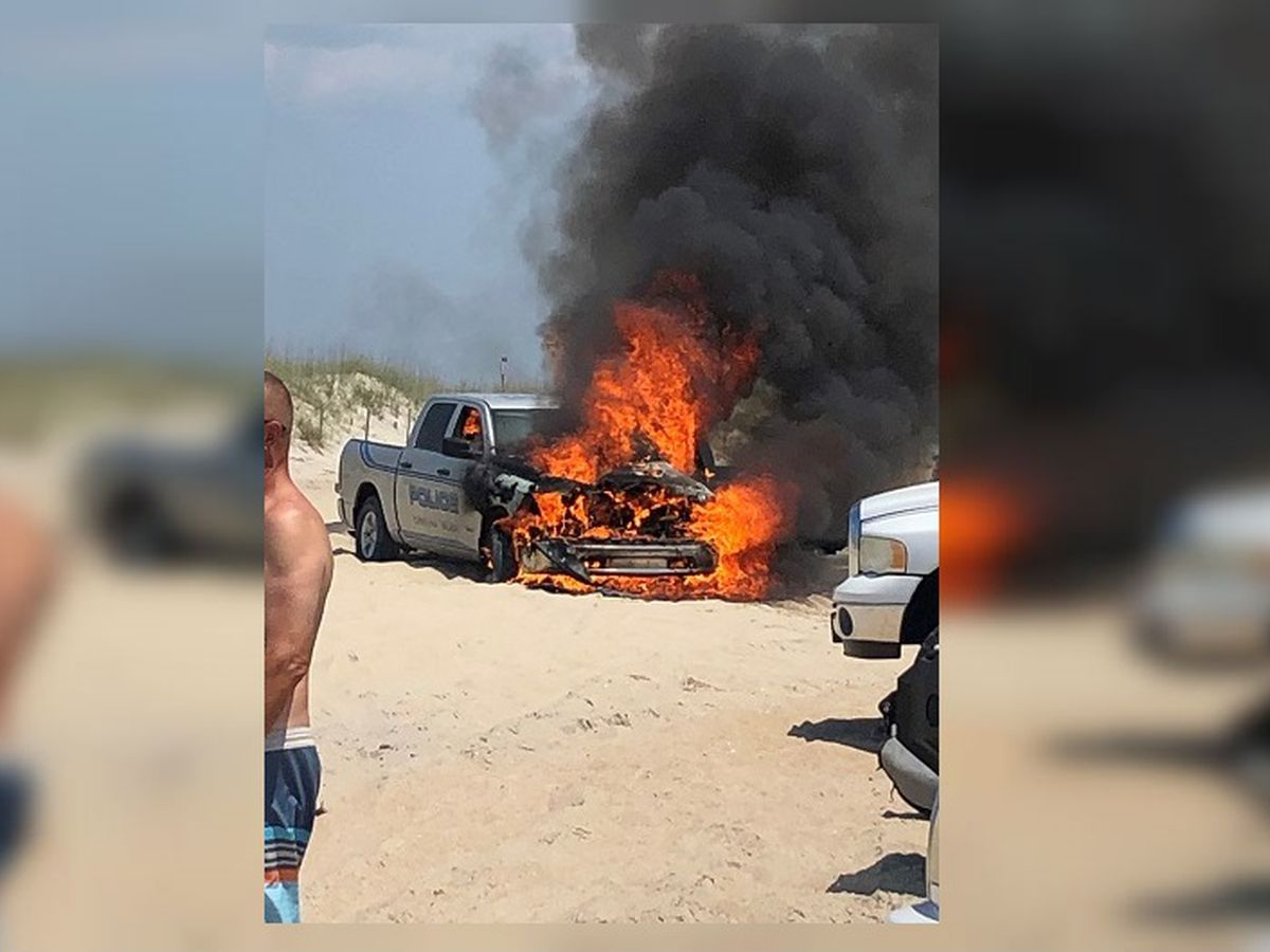 Police vehicle catches fire at Carolina Beach