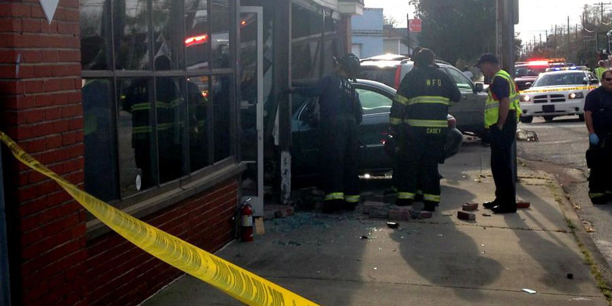 UPDATE: Drivers cited after car crashes into building on Castle Street