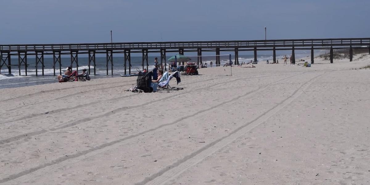 Ocean Isle Beach-goers practice social distancing on the shore