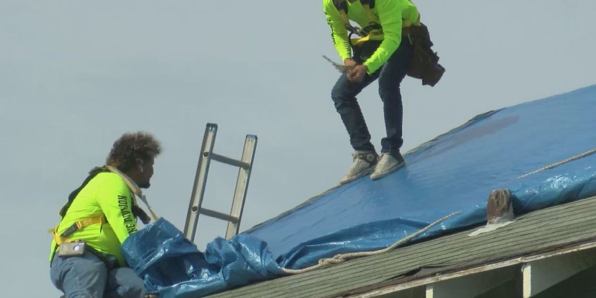Roofers to the rescue: Crews install emergency tarps ahead of Michael