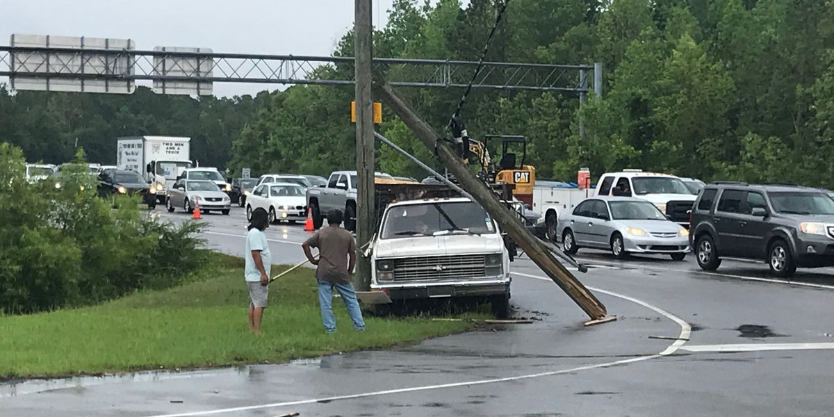 TRAFFIC ALERT: Lanes reopen after damaged power pole, dangling traffic lights create delays at N. College, MLK Blvd.