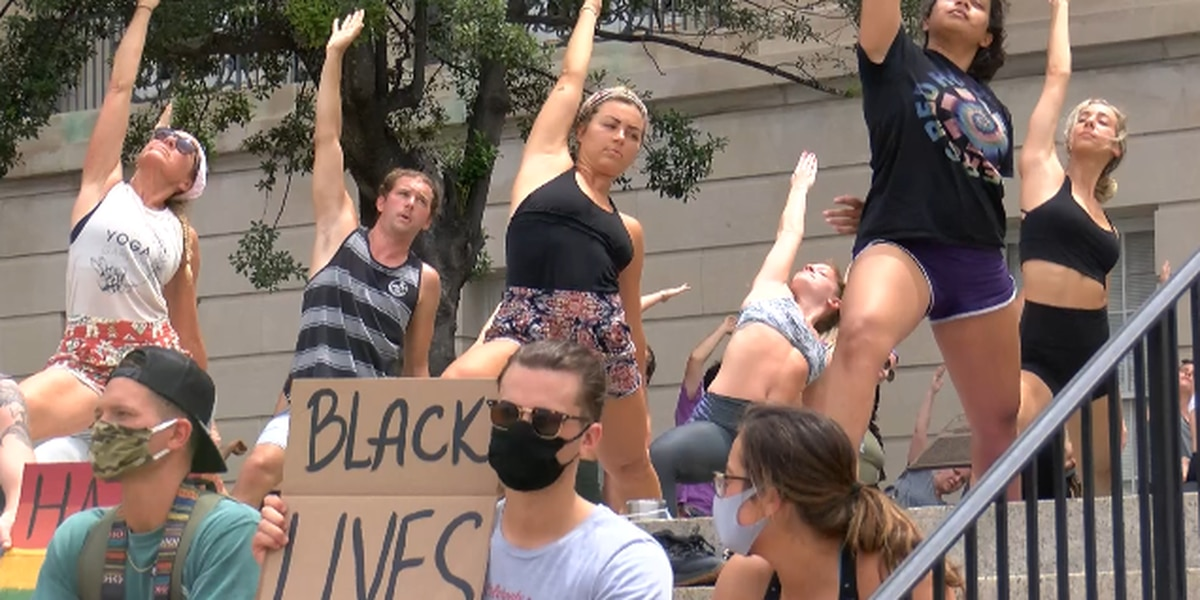 Downtown Wilmington peaceful protest takes the form of yoga