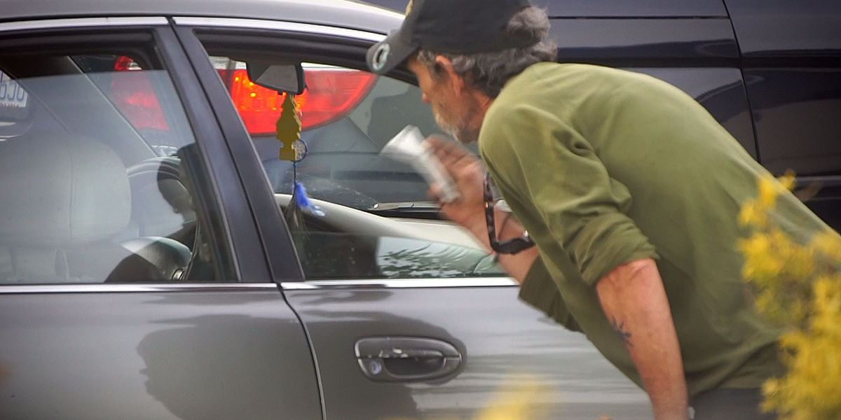 What should you give to panhandlers to help?