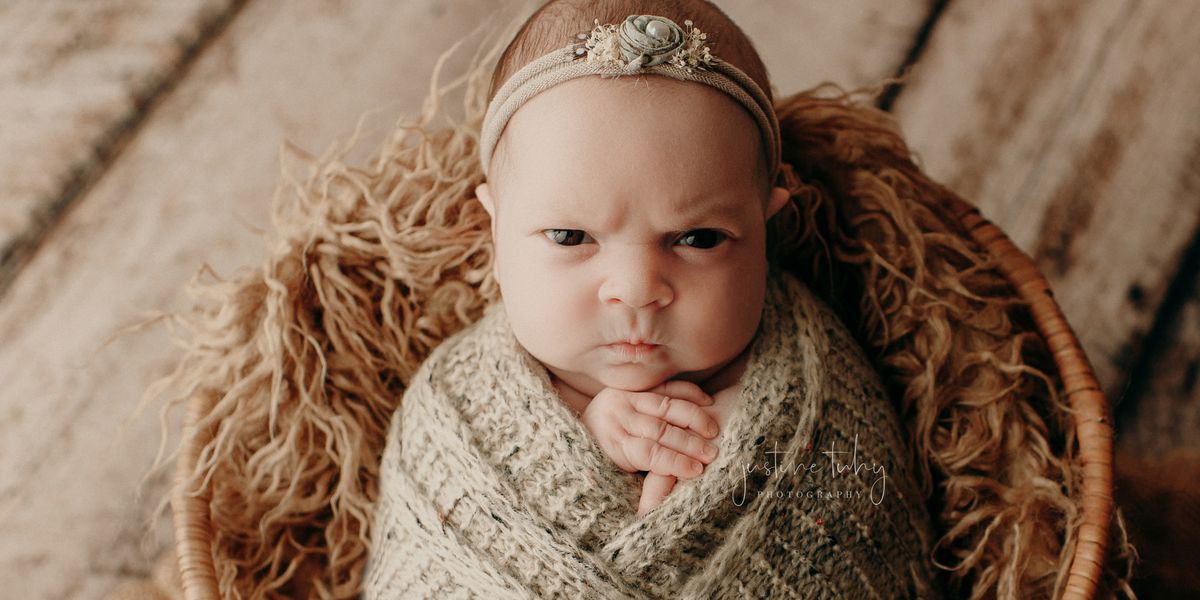 Adorable baby girl with grumpy expression captured in Ohio photographer's pictures