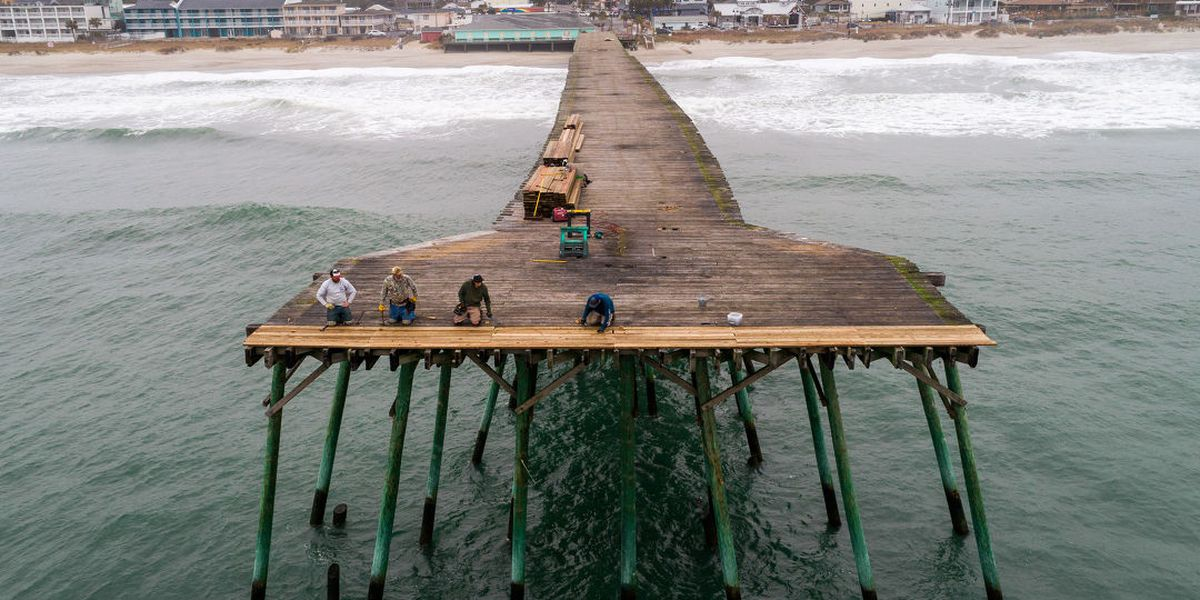 DRONE VIDEO: Workers replace decking on the Kure Beach Pier