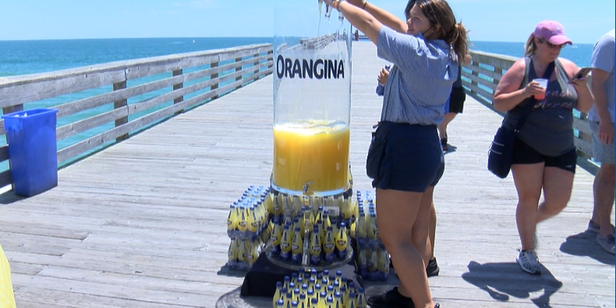 Oceanic fills giant champagne flute with Orangina in fundraising event