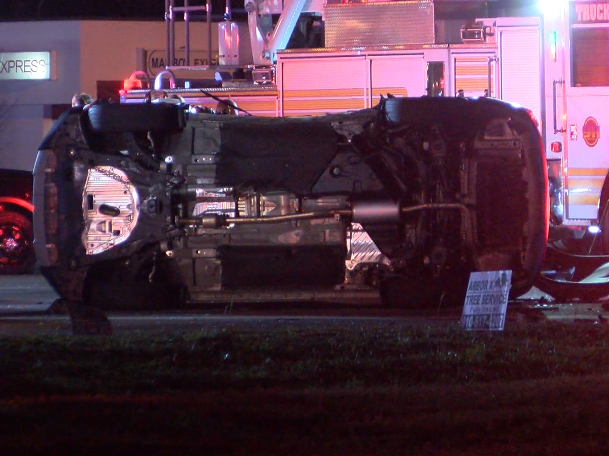 Car flipped on its side after chain reaction crash in Monkey Junction, four hospitalized