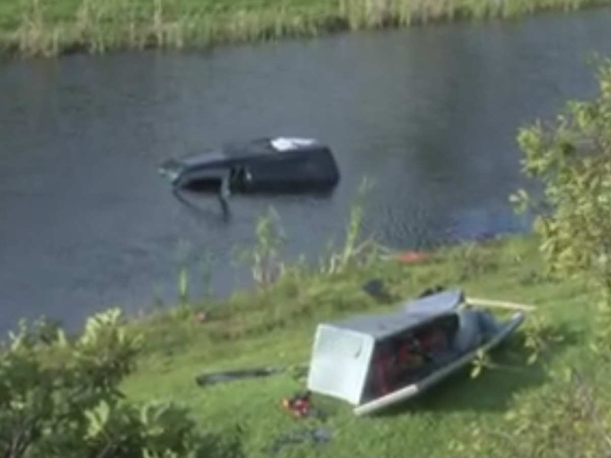 Driver, dog rescued from car submerged in pond off Sanders Road
