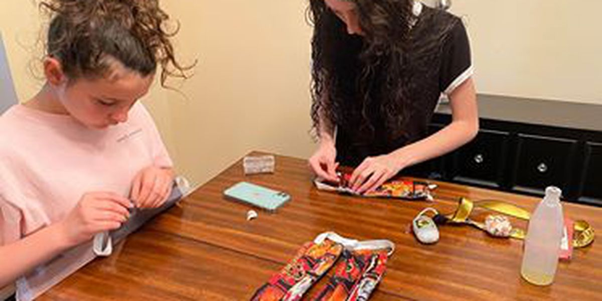 Two sisters team up to make masks for first responders