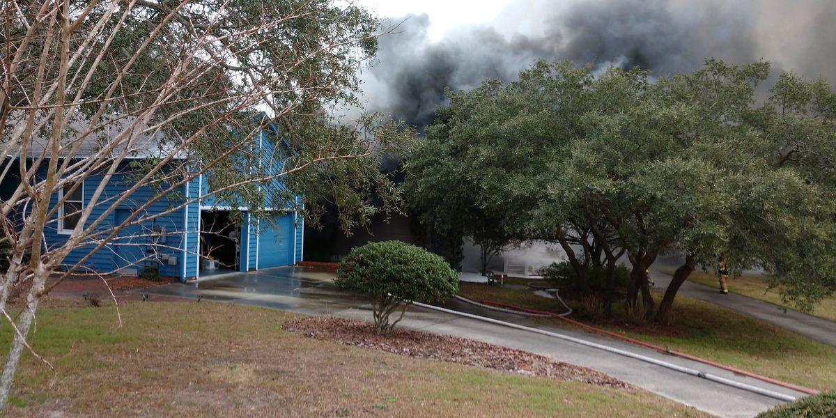 Crews battle New Hanover County house fire