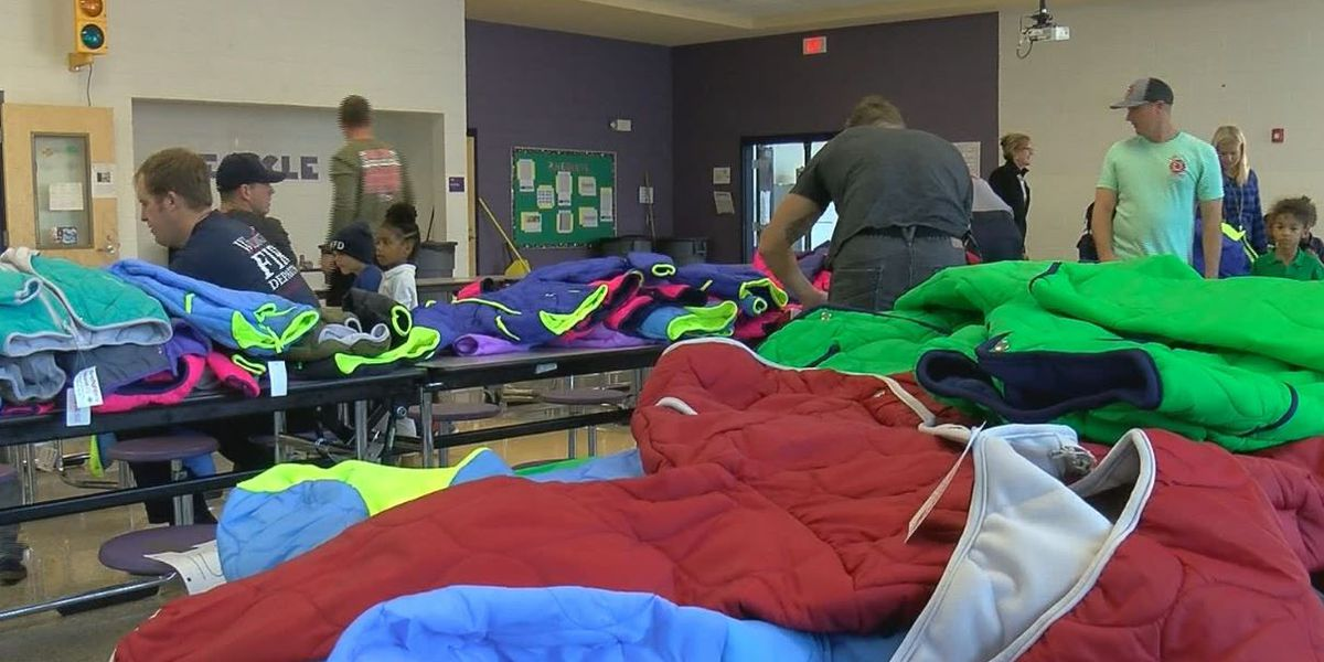 Wilmington firefighters provide new coats for Snipes students