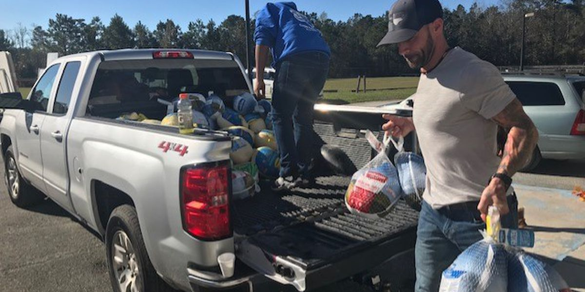 Brunswick County small business owners giveaway 500 Thanksgiving dinners during their own time of need
