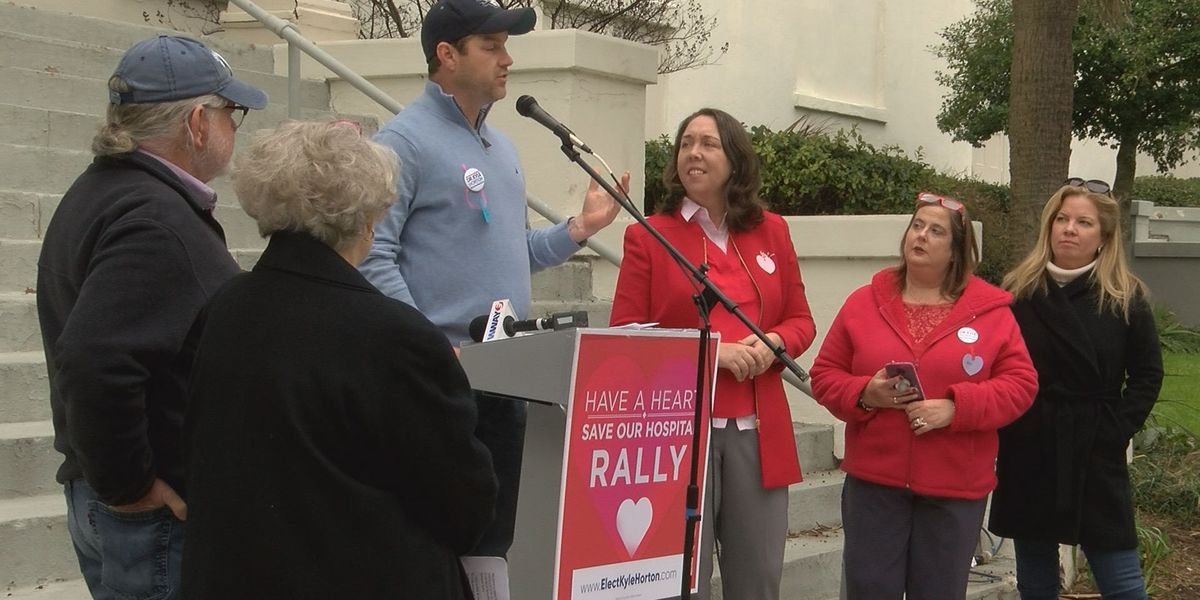 Group rallies, seeks signatures for delay petition