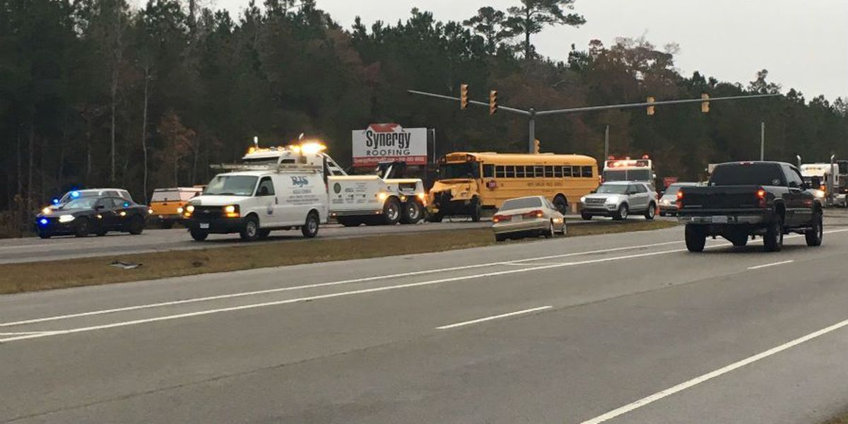New Hanover school bus involved in wreck with log truck on US 17