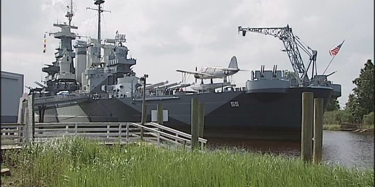 Battleship relieves volunteer of duties over criminal history, allows inmates to work on ship