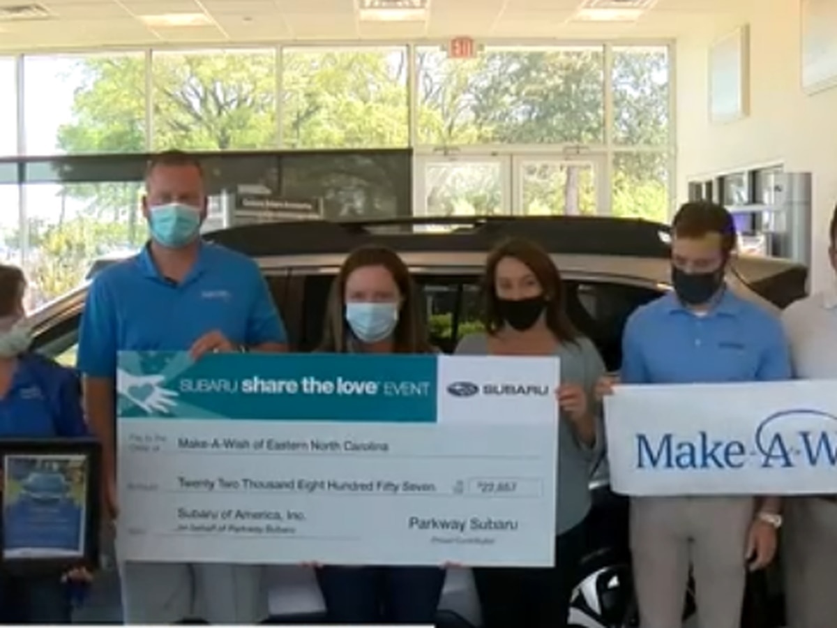 Car dealership presents check to the Make-A-Wish foundation