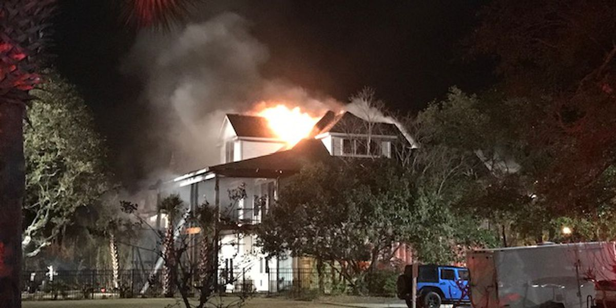 Crews battle house fire in Carolina Beach