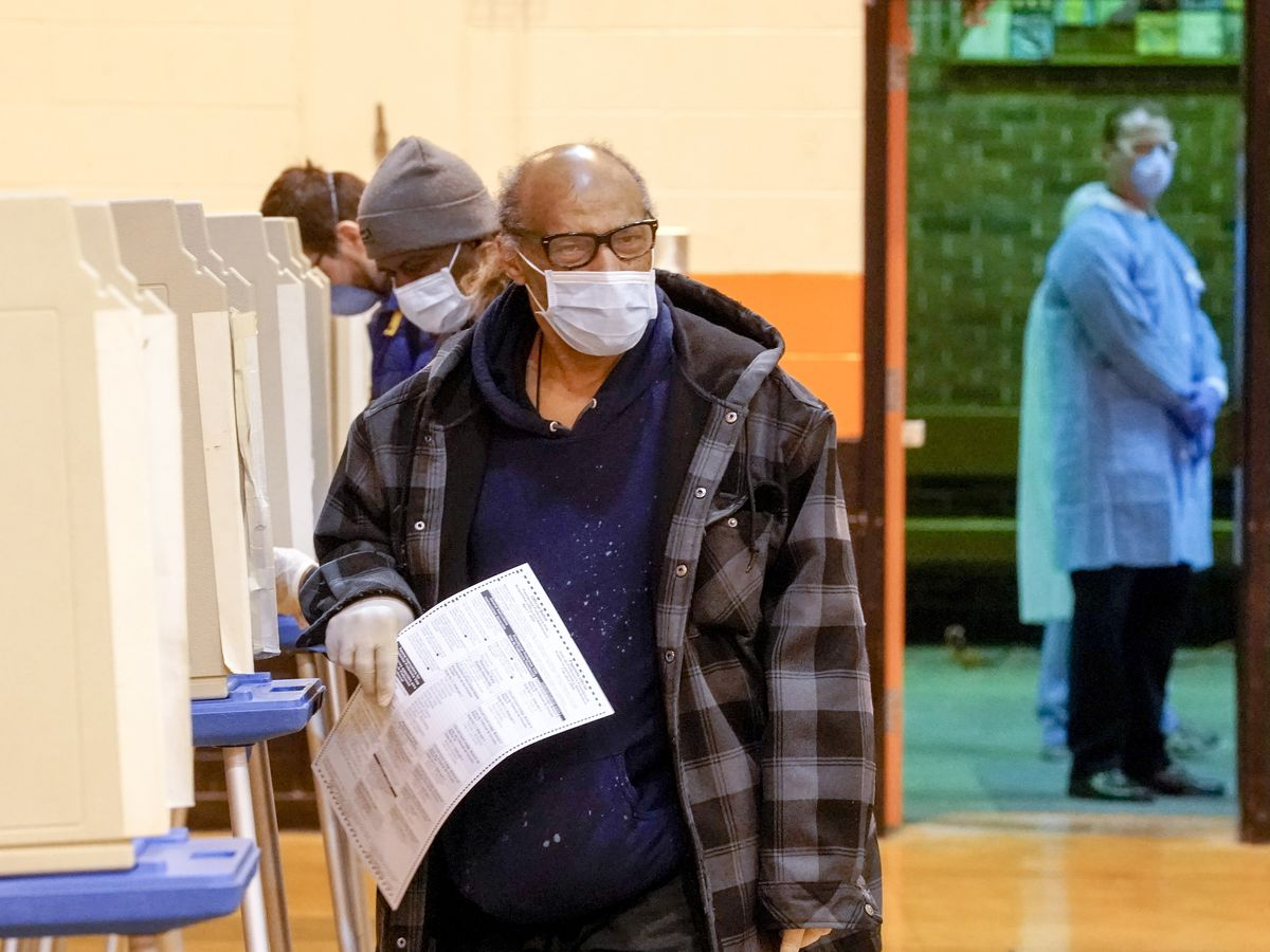 Wisconsin voters forced to choose between health, democracy